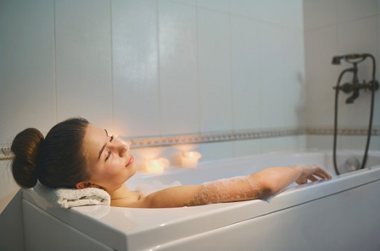 Women taking detox bath